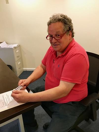 MARK, DIRECTOR OF STAMP REDEMPTION PROGRAM, PREPARES ORDERS